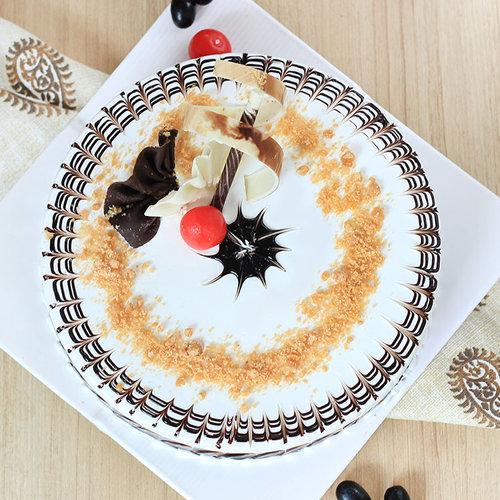 https://media.bakingo.com/sites/default/files/round-shaped-butterscotch-cake-1-cake1938butt-B.jpg