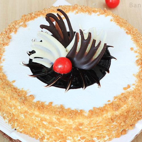 https://media.bakingo.com/sites/default/files/round-shaped-butterscotch-cake-2-in-bangalore-cake847butt-C.jpg