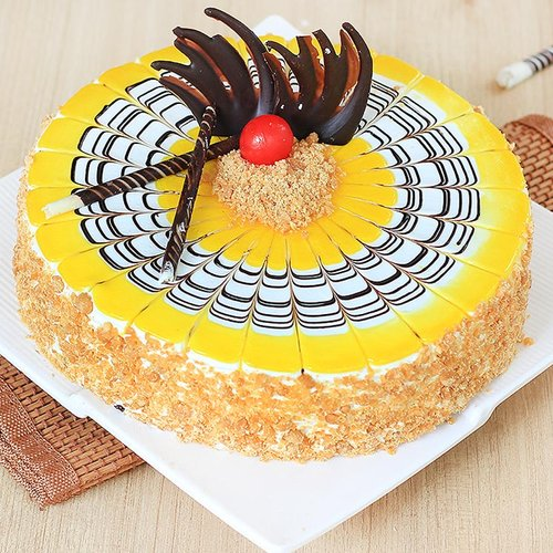 https://media.bakingo.com/sites/default/files/round-shaped-butterscotch-cake-3-cake1490butt-A.jpg