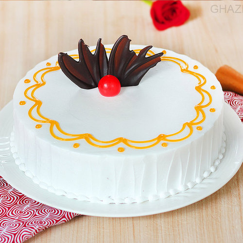 https://media.bakingo.com/sites/default/files/round-shaped-vanilla-cake-1-in-ghaziabad-cake0970flav-a.jpg