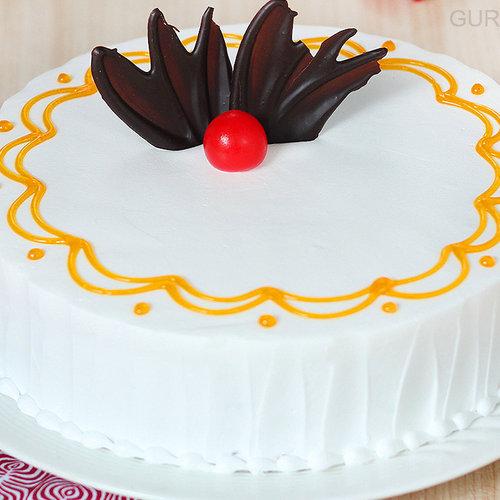 https://media.bakingo.com/sites/default/files/round-shaped-vanilla-cake-1-in-gurgaon-cake0936flav-c.jpg