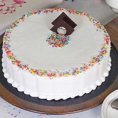 https://media.bakingo.com/sites/default/files/round-shaped-vanilla-cake-2-in-bangalore-cake1049flav-a_0.jpg