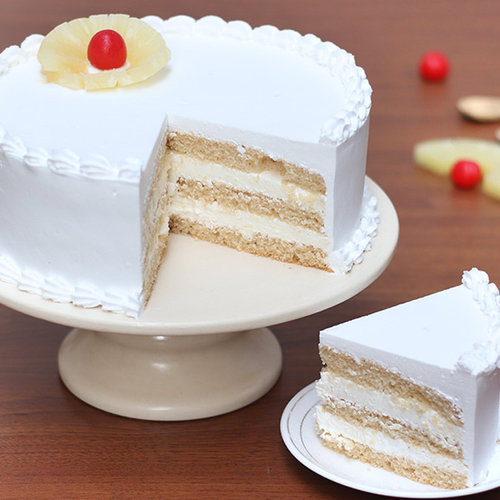 https://media.bakingo.com/sites/default/files/round-shaped-vanilla-cake-4-bangalore-cake983vani-C.jpg