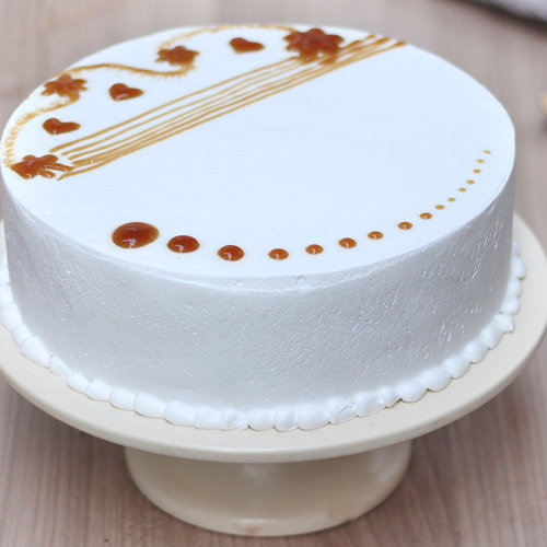 https://media.bakingo.com/sites/default/files/round-shaped-vanilla-cake-4-cake904vani-D.jpg