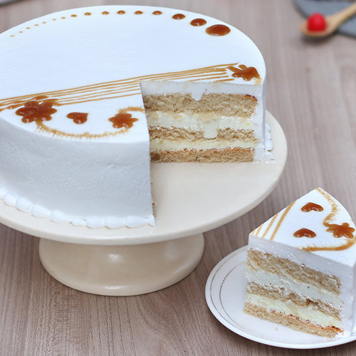 https://media.bakingo.com/sites/default/files/round-shaped-vanilla-cake-4-cake904vani-F.jpg