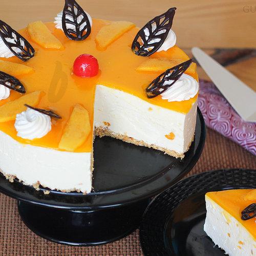 https://media.bakingo.com/sites/default/files/sliced-view-of-mango-cheese-cake-in-gurgaon-cake0826flav-b.jpg