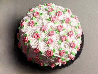 Top View of Floral Swirls Strawberry Cream Cake