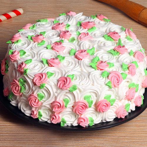 https://media.bakingo.com/sites/default/files/strawberry-cream-cake-1-cake1965stra-A.jpg