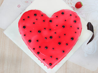 Top View of A Delicious Heart Shaped Strawberry Cake