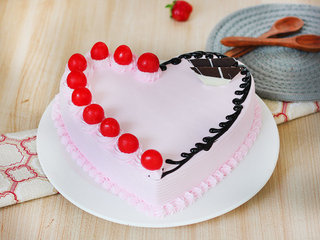 Heart Shaped Strawberry Cake with Cherry Toppings
