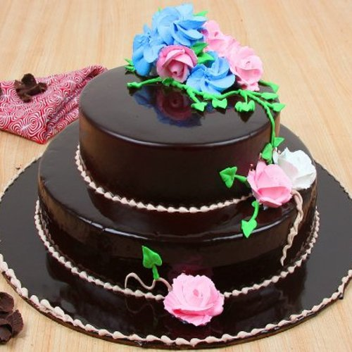 https://media.bakingo.com/sites/default/files/styles/product_image/public/2-tier-glossy-chocolate-cake--part0684choc-A.jpg?tr=h-500,w-500