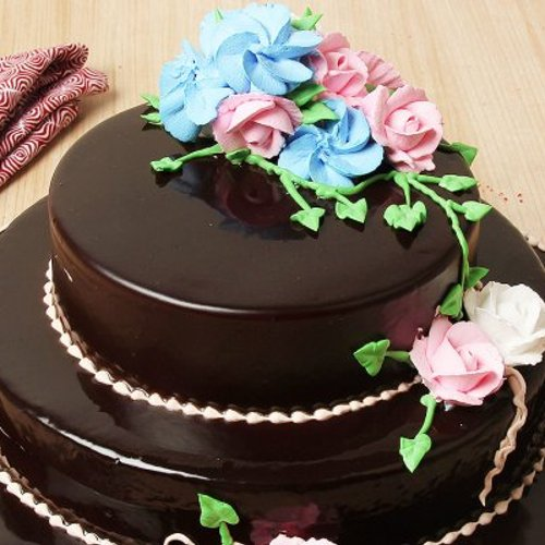 https://media.bakingo.com/sites/default/files/styles/product_image/public/2-tier-glossy-chocolate-cake--part0684choc-C.jpg?tr=h-500,w-500