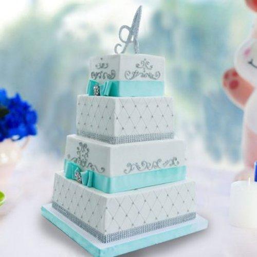 https://media.bakingo.com/sites/default/files/styles/product_image/public/4-tier-anniversary-cake-part1353flav.jpg?tr=h-500,w-500