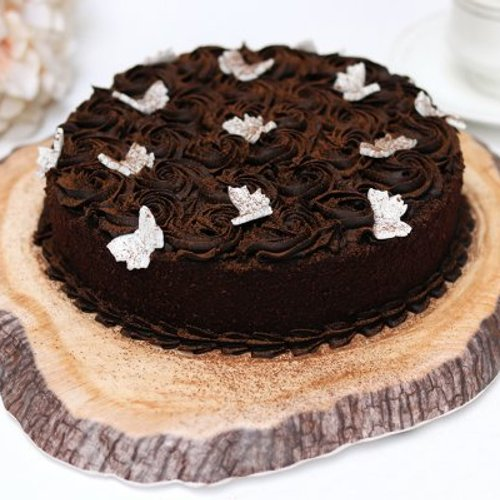 https://media.bakingo.com/sites/default/files/styles/product_image/public/Round Chocolate Truffle Cake A.JPG?tr=h-500,w-500