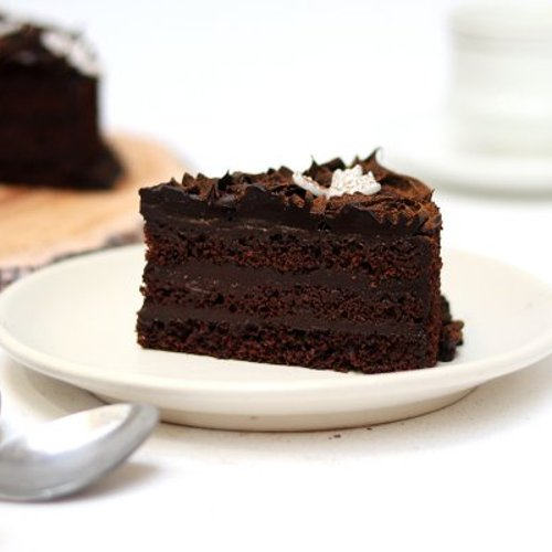 https://media.bakingo.com/sites/default/files/styles/product_image/public/Round Chocolate Truffle Cake D.JPG?tr=h-500,w-500
