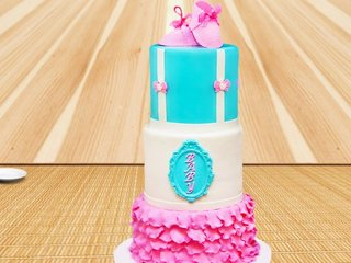 Three tier fondant cake with shoes on top
