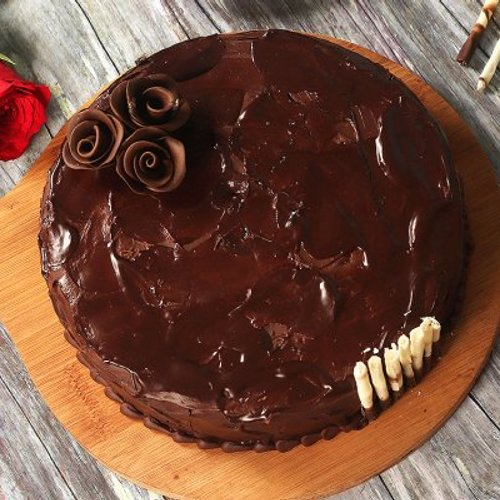 https://media.bakingo.com/sites/default/files/styles/product_image/public/belgian-chocolate-cake-cake1533choc-B.jpg?tr=h-500,w-500