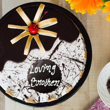 https://media.bakingo.com/sites/default/files/styles/product_image/public/bhai-dooj-choco-vanilla-cake-cake948chva-C_0.png?tr=h-360,w-360