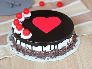 Black forest cake with fondant heart and cherries