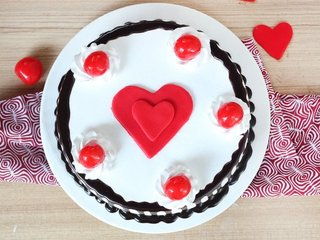 Top View of Black Forest Cake with Fondant Heart and 5 Cherries