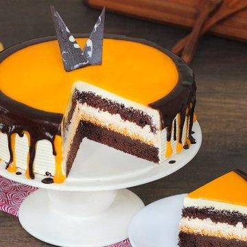 https://media.bakingo.com/sites/default/files/styles/product_image/public/choco-orange-cake-in-delhi-cake0877flav-b.jpg?tr=h-360,w-360