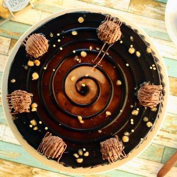 https://media.bakingo.com/sites/default/files/styles/product_image/public/ferrero-rocher-choco-cake-cake1139choc-B.jpg?tr=h-360,w-360