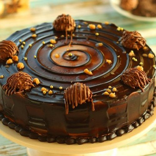 https://media.bakingo.com/sites/default/files/styles/product_image/public/ferrero-rocher-choco-cake-cake1260choc-A.jpg?tr=h-500,w-500