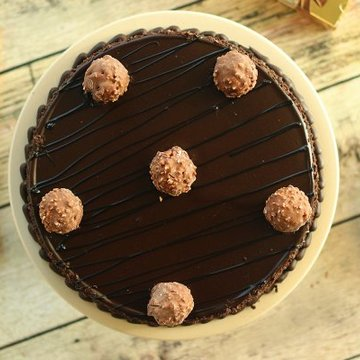 https://media.bakingo.com/sites/default/files/styles/product_image/public/ferrero-rocher-chocolate-cake-cake1259choc-B.jpg?tr=h-360,w-360