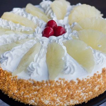 https://media.bakingo.com/sites/default/files/styles/product_image/public/hawaiian-pineapple-cake-C.jpg?tr=h-360,w-360