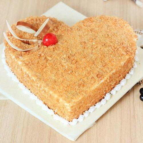 https://media.bakingo.com/sites/default/files/styles/product_image/public/heart-shaped-butterscotch-cake-1-cake0620hbut-A.jpg?tr=h-500,w-500