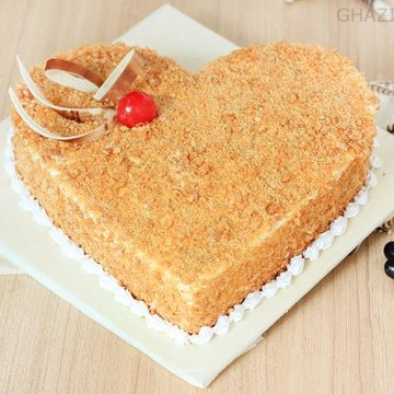 https://media.bakingo.com/sites/default/files/styles/product_image/public/heart-shaped-butterscotch-cake-1-in-ghaziabad-cake872butt-A.jpg?tr=h-360,w-360