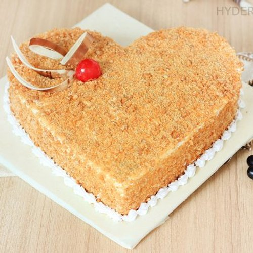 https://media.bakingo.com/sites/default/files/styles/product_image/public/heart-shaped-butterscotch-cake-1-in-hyderabad-cake864butt-A.jpg?tr=h-500,w-500