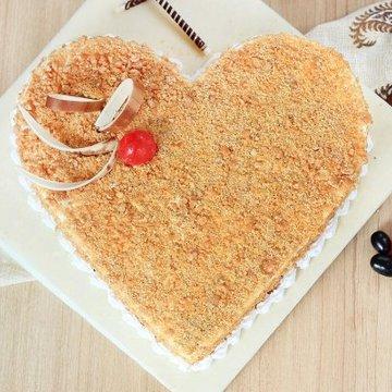 https://media.bakingo.com/sites/default/files/styles/product_image/public/heart-shaped-butterscotch-cake-1-in-noida-cake856butt-B.jpg?tr=h-360,w-360