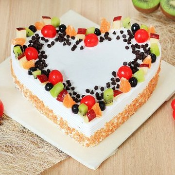 https://media.bakingo.com/sites/default/files/styles/product_image/public/heart-shaped-fruit-cake-1-in-bangalore-cake1032flav-a.jpg?tr=h-360,w-360