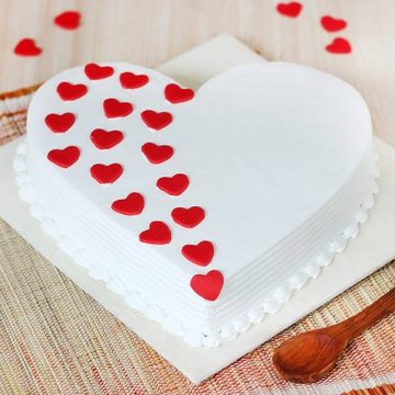 https://media.bakingo.com/sites/default/files/styles/product_image/public/heart-shaped-vanilla-cake-1-in-delhi-cake0887flav-a.jpg?tr=h-360,w-360