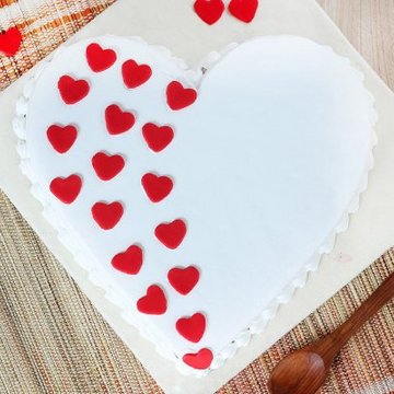https://media.bakingo.com/sites/default/files/styles/product_image/public/heart-shaped-vanilla-cake-1-in-delhi-cake0887flav-b.jpg?tr=h-360,w-360