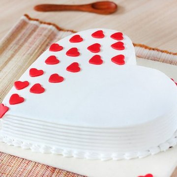 https://media.bakingo.com/sites/default/files/styles/product_image/public/heart-shaped-vanilla-cake-1-in-delhi-cake0887flav-c.jpg?tr=h-360,w-360