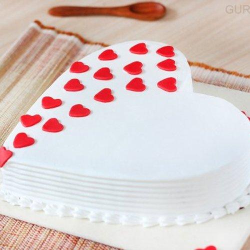 https://media.bakingo.com/sites/default/files/styles/product_image/public/heart-shaped-vanilla-cake-1-in-gurgaon-cake0923flav-c.jpg?tr=h-500,w-500