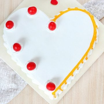 https://media.bakingo.com/sites/default/files/styles/product_image/public/heart-shaped-vanilla-cake-2-in-bangalore-cake1036flav-b.jpg?tr=h-360,w-360