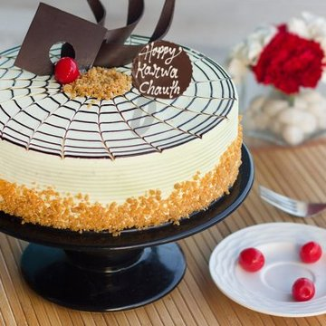 https://media.bakingo.com/sites/default/files/styles/product_image/public/karwa-chauth-butterscotch-cake-cake931butt-A_0.jpg?tr=h-360,w-360