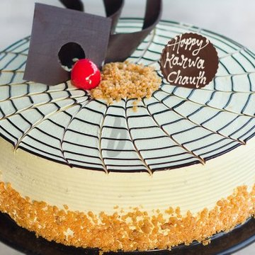 https://media.bakingo.com/sites/default/files/styles/product_image/public/karwa-chauth-butterscotch-cake-cake931butt-C_0.jpg?tr=h-360,w-360