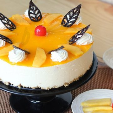 https://media.bakingo.com/sites/default/files/styles/product_image/public/mango-cheese-cake-A.jpg?tr=h-360,w-360