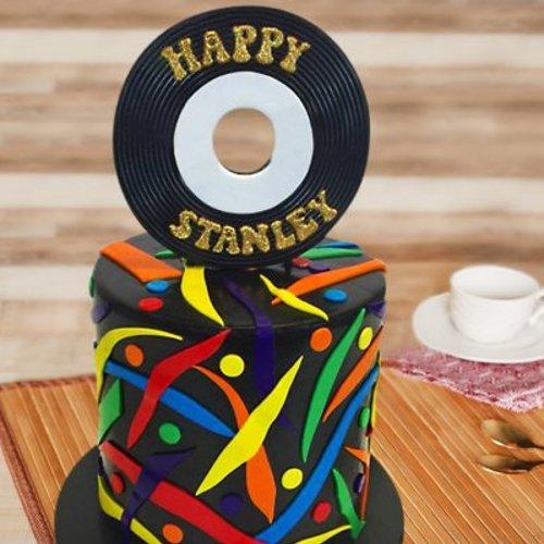 https://media.bakingo.com/sites/default/files/styles/product_image/public/musical-cd-fondant-cake-them0433flav.jpg?tr=h-500,w-500