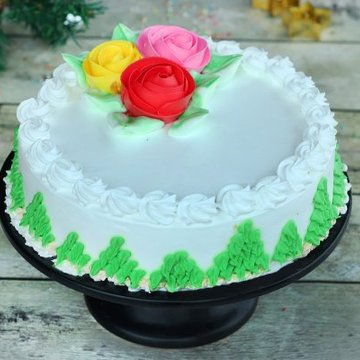 https://media.bakingo.com/sites/default/files/styles/product_image/public/pineapple-cream-cake-with-roses-cake1523pine-A.jpg?tr=h-360,w-360