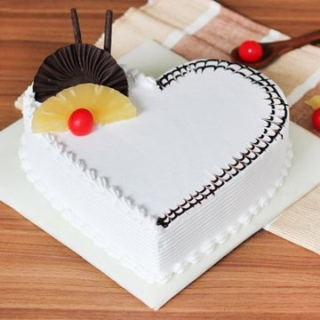 https://media.bakingo.com/sites/default/files/styles/product_image/public/pineapple-heart-shaped-cake-2-cake0636pine-A_0.jpg?tr=h-360,w-360