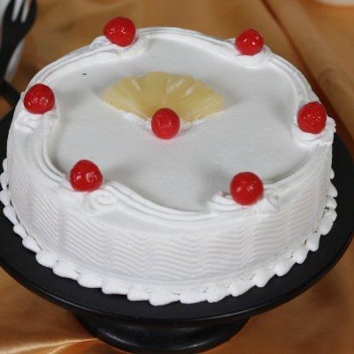 https://media.bakingo.com/sites/default/files/styles/product_image/public/pineapple-round-shaped-cake-2-cake0632pine-C.JPG?tr=h-500,w-500