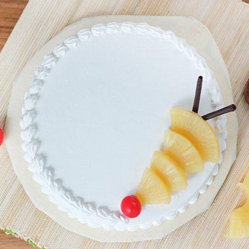 https://media.bakingo.com/sites/default/files/styles/product_image/public/pineapple-round-shaped-cake-2-cake1531pine-B.jpg?tr=h-500,w-500