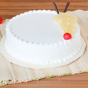 https://media.bakingo.com/sites/default/files/styles/product_image/public/pineapple-round-shaped-cake-2-cake1553pine-A.jpg?tr=h-360,w-360