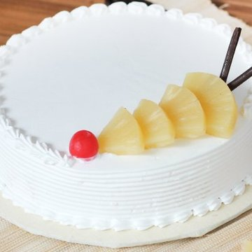 https://media.bakingo.com/sites/default/files/styles/product_image/public/pineapple-round-shaped-cake-2-cake1553pine-C.jpg?tr=h-360,w-360