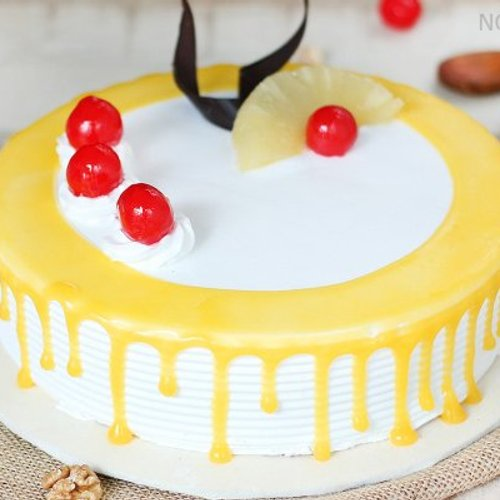 https://media.bakingo.com/sites/default/files/styles/product_image/public/pineapple-round-shaped-cake-4-in-noida-cake849pine-C.jpg?tr=h-500,w-500